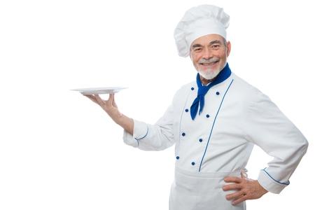 cocinero: Chef presenta. Aisladas sobre fondo blanco Foto de archivo