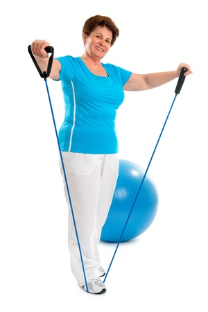 strong women: senior woman doing exercises with a resistance band