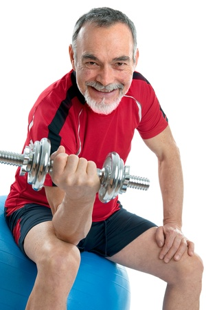 dumbells: Senior man working with weights in gym