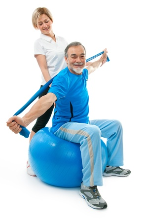 home trainer: Senior man doing fitness exercise with help of trainer at sport gym
