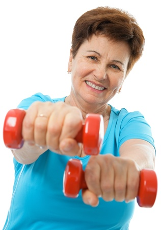 home gym: Senior woman working with weights in gym Stock Photo