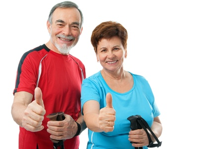 happy senior couple showing thumbs up isolated on white  photo