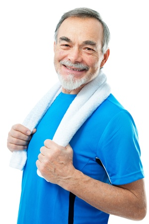 relaxed senior with a towel around his neck photo