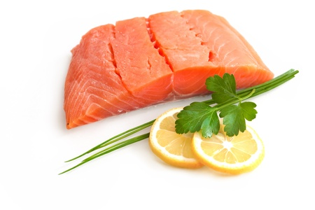 fresh salmon fillet with parsley and lemon slices  Stock Photo