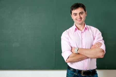 high school teacher: smiling student or teacher at the blackboard Stock Photo