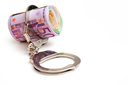 Euro notes with a pair of handcuffs photo