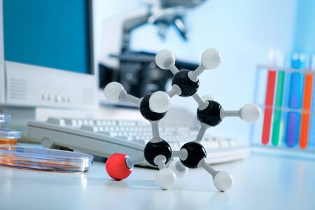 A molecule model and test tubes at the lab photo