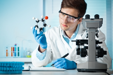 molecular structure: scientist with a molecular structure at the lab