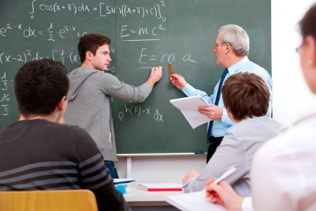 high school teacher: teacher with a group of high school students  in classroom