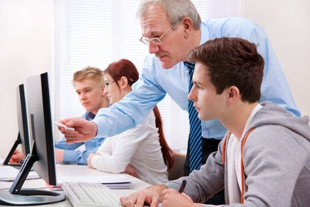 classroom training: Students with a teacher in computer classroom