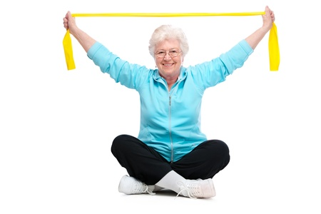 elastic: senior woman doing exercises with a resistance band Stock Photo