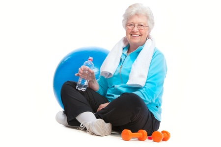 old woman: senior woman resting after exercises In gym