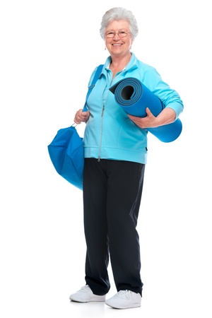 rehab: Attractive senior woman with a sports bag and mat Stock Photo