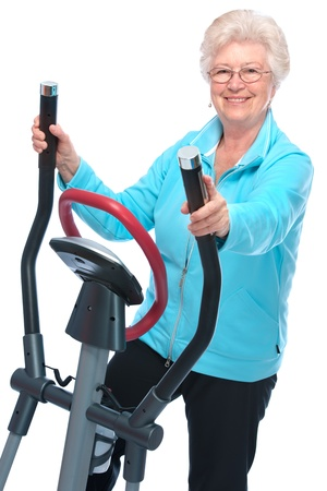 health club: Attractive senior woman at health club, exercising on stepper