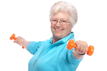 physical fitness: Happy senior woman making fitness training with dumbbells Stock Photo