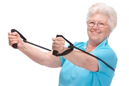 senior exercise: senior woman doing exercises with a resistance band Stock Photo