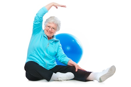 Attractive senior woman at health club, doing stretching exercises photo