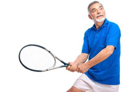 70s tennis: senior man playing tennis. Isolated on white