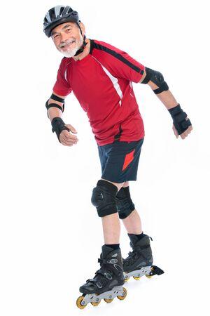 rollerblading: senior man goes inline skating Stock Photo