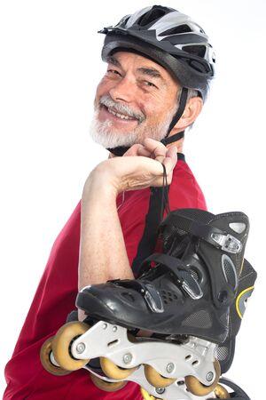 senior man goes inline skating photo