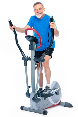 health club: Attractive senior man at health club, exercising on stepper