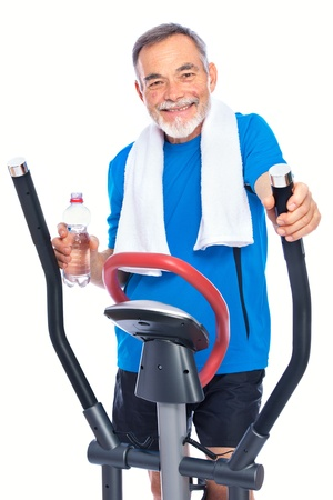 Attractive senior man at health club, exercising on stepper Stock Photo - 13203154