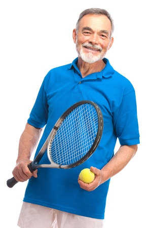 Happy senior man with a tennis racket photo