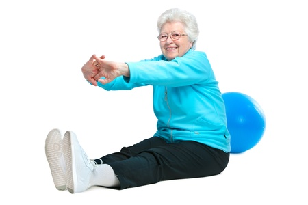 stretchy: Attractive senior woman at health club, doing  stretching exercises