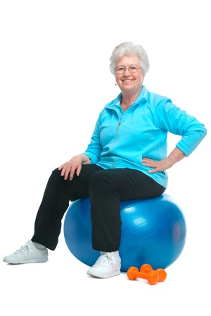 Attractive senior woman at health club, doing exercises photo