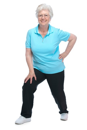 health club: Attractive senior woman at health club, doing  stretching exercises