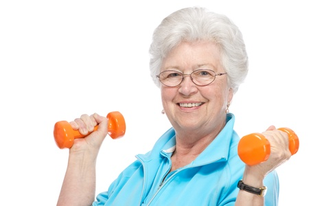 Happy senior woman making fitness training with dumbbells photo
