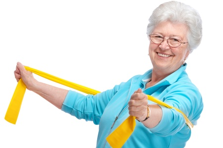 elastic band: senior woman doing exercises with a resistance band Stock Photo