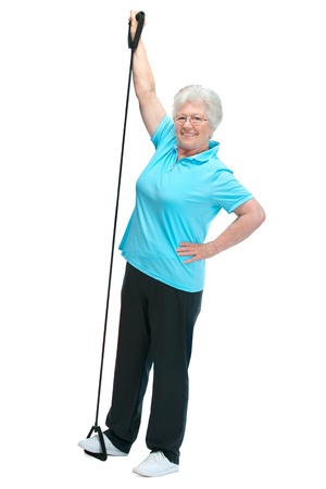 stretchy: Attractive senior woman at health club, doing exercises with a chest expander