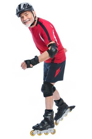 inline skater: senior man goes inline skating Stock Photo
