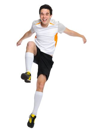 soccer player jumps up and shouts with joy photo