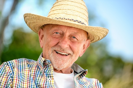 straw hat: Portrait of senior man outdoors