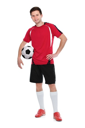 soccer player with a ball on white background photo