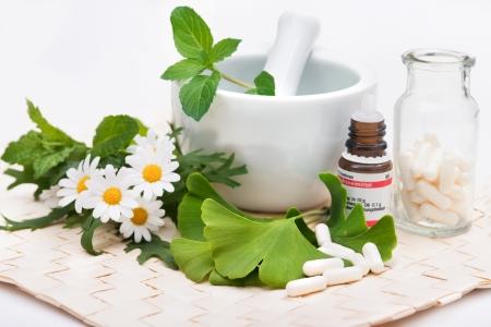 Healing herbs in mortar  Alternative medicine concept photo