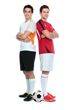 Soccer players standing  back to back  Isolated on white background photo