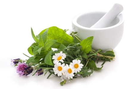 chamomile flower: Healing herbs and amortar. Alternative medicine concept