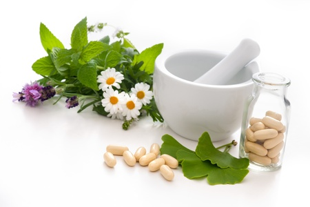 Healing herbs and amortar. Alternative medicine concept photo