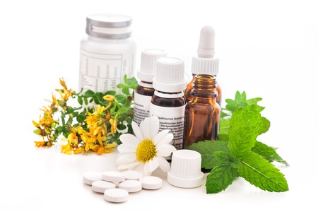 homeopathic: Healing herbs and medicinal bottles. Alternative medicine concept