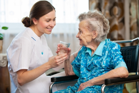 seniors homes: Senior woman with her caregiver at home Stock Photo