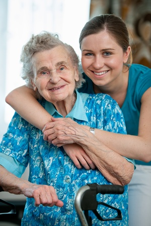 grandmother grandchild: Senior woman with her caregiver at home Stock Photo