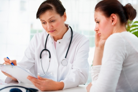 happy doctor woman: doctor explaining diagnosis to her female patient Stock Photo