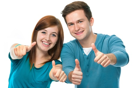 approval: happy teens showing thumbs up Stock Photo