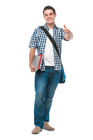 sign university: Happy teenager with the books shows thumbs up Stock Photo