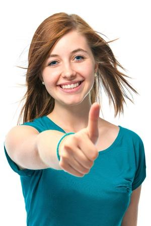 thumbs up woman: female teenager shows a thumbs up on white background