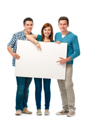university sign: Group of teens standing together and holding a blank board