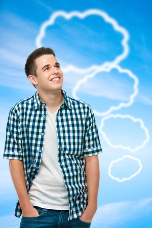 Teenager with blank thought bubbles on blue sky background photo